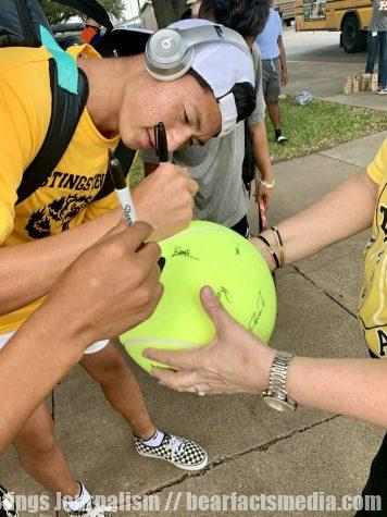 Senior Hieu Phan signs autographs along with his teammates as they head to regionals.